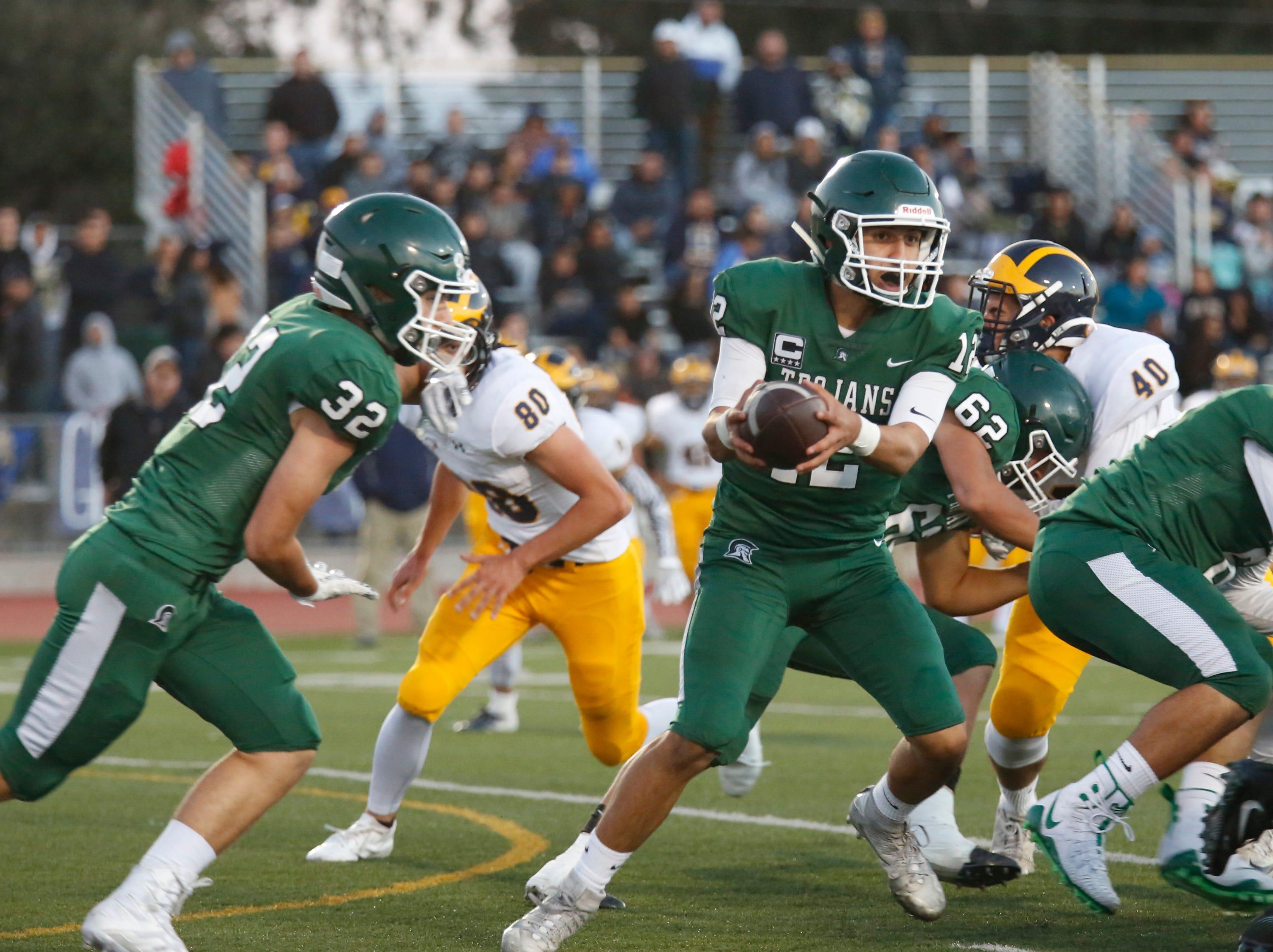 Alisal's quarterback Julian Renteria hands off to Dorian Segovia against Everett Alvarez during football at Alisal High School in Salinas on Friday August 31, 2018. (Photo By David Royal)