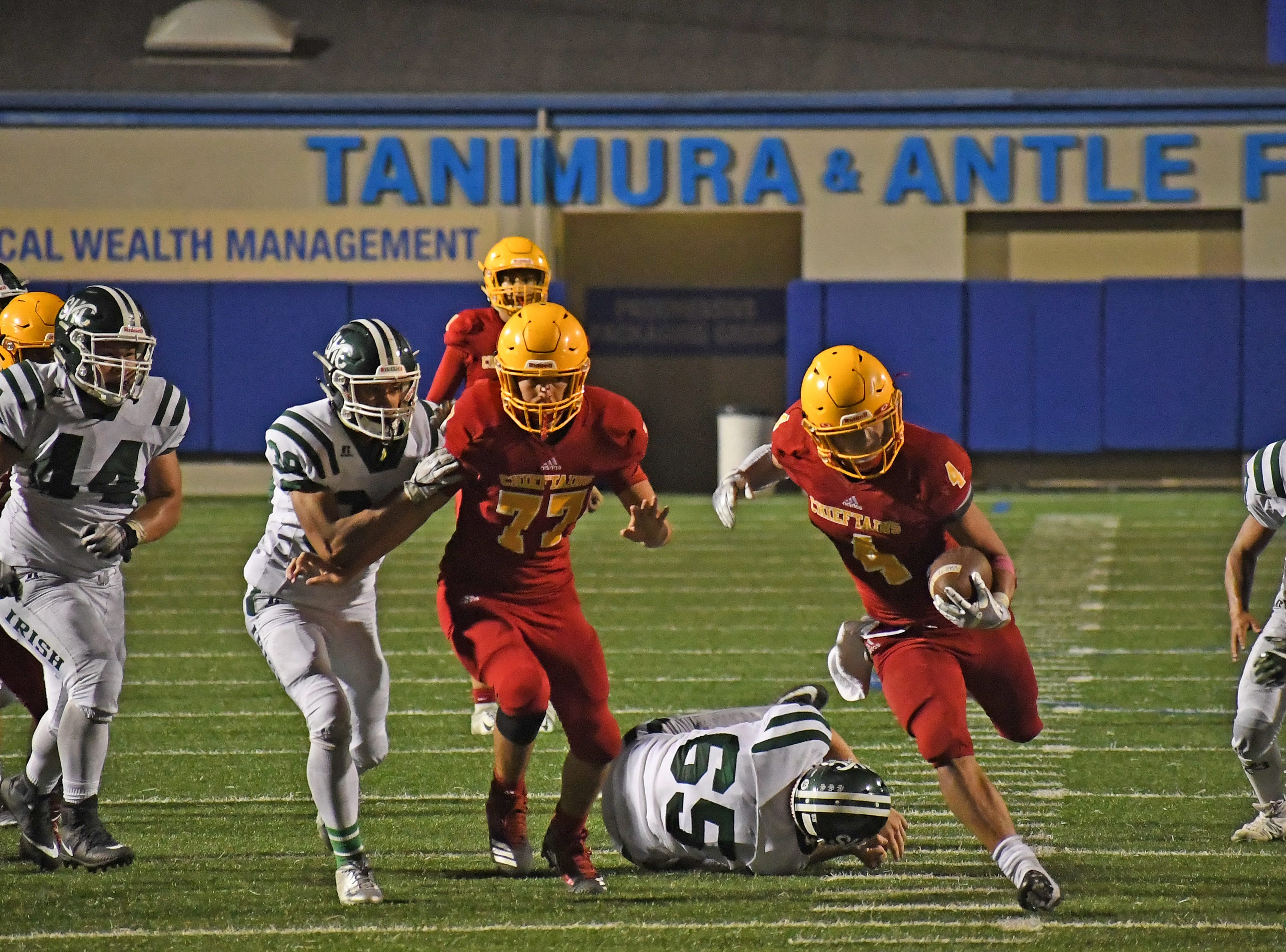 Palma junior running back Anthony Villegas (4) sprints through a hole in the fourth quarter.