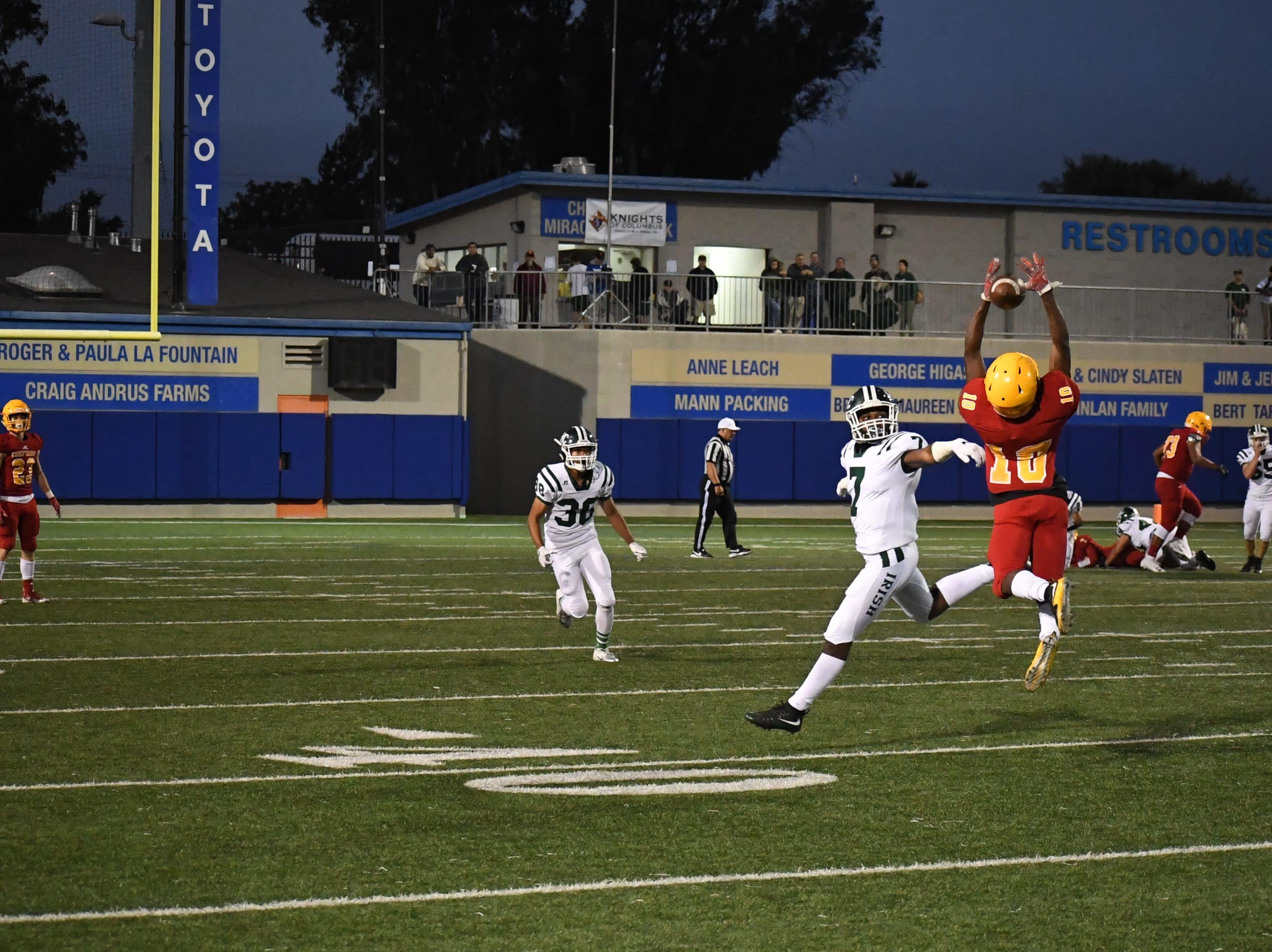 Palma junior Jon Jon Berring (10) can't corral a pass from quarterback Grant Sergent.