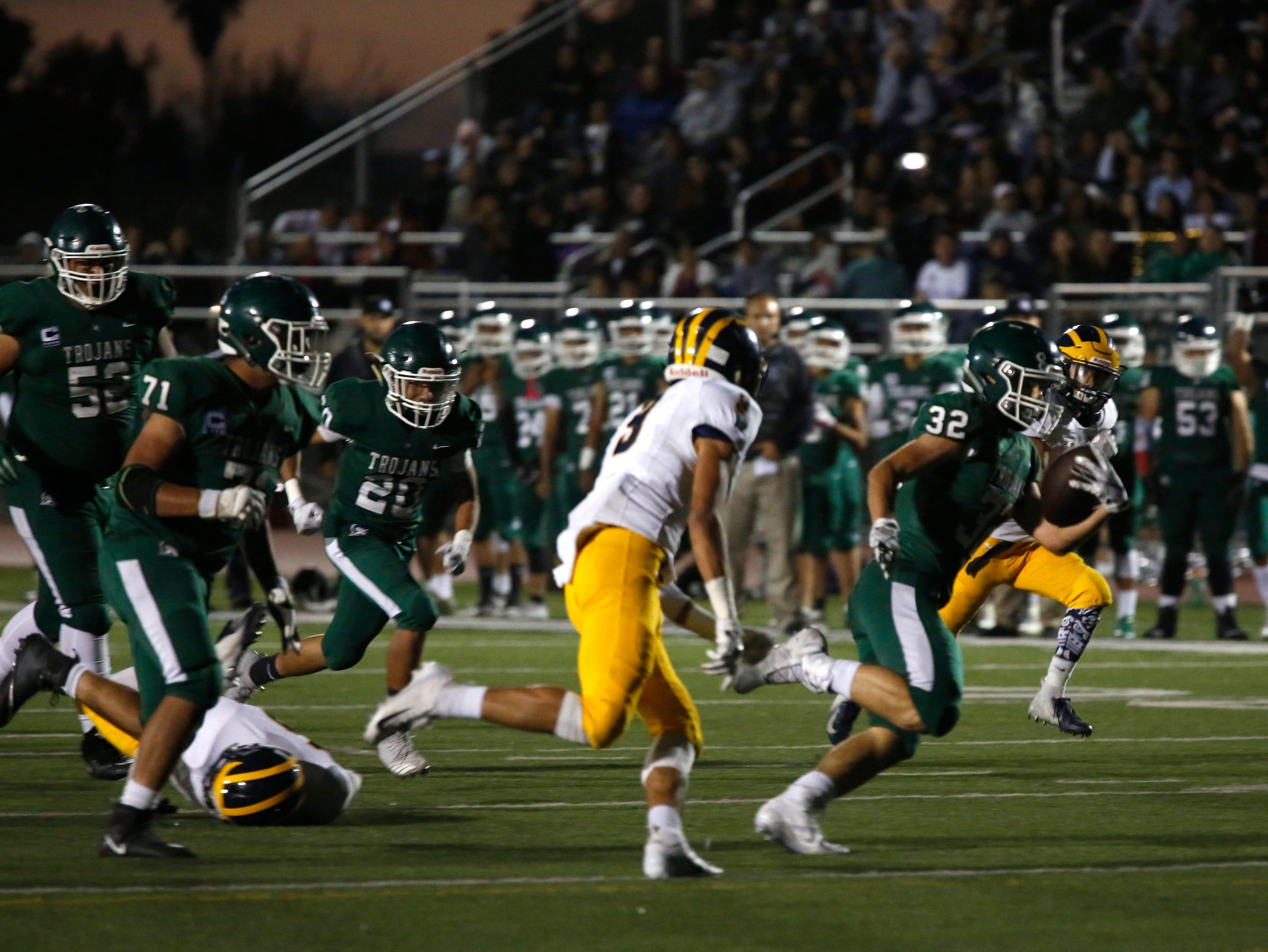 Alisal's Dorian Segovia runs the ball against Everett Alvarez during football at Alisal High School in Salinas on Friday August 31, 2018. (Photo By David Royal)