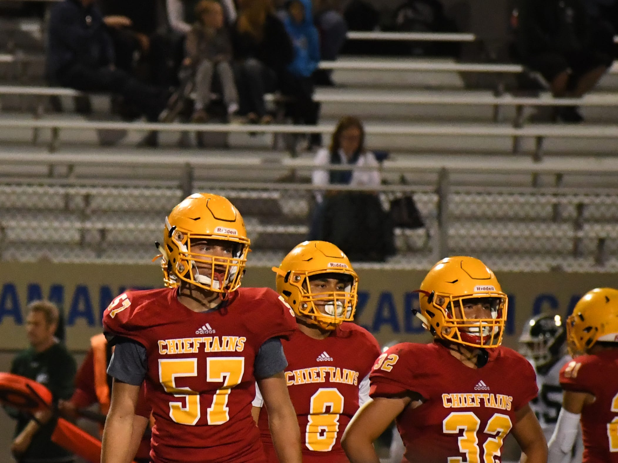 Defenders Dane Golden (57), Matthew Isais (8) and Diego Guajardo (32) look to the sideline during a timeout.