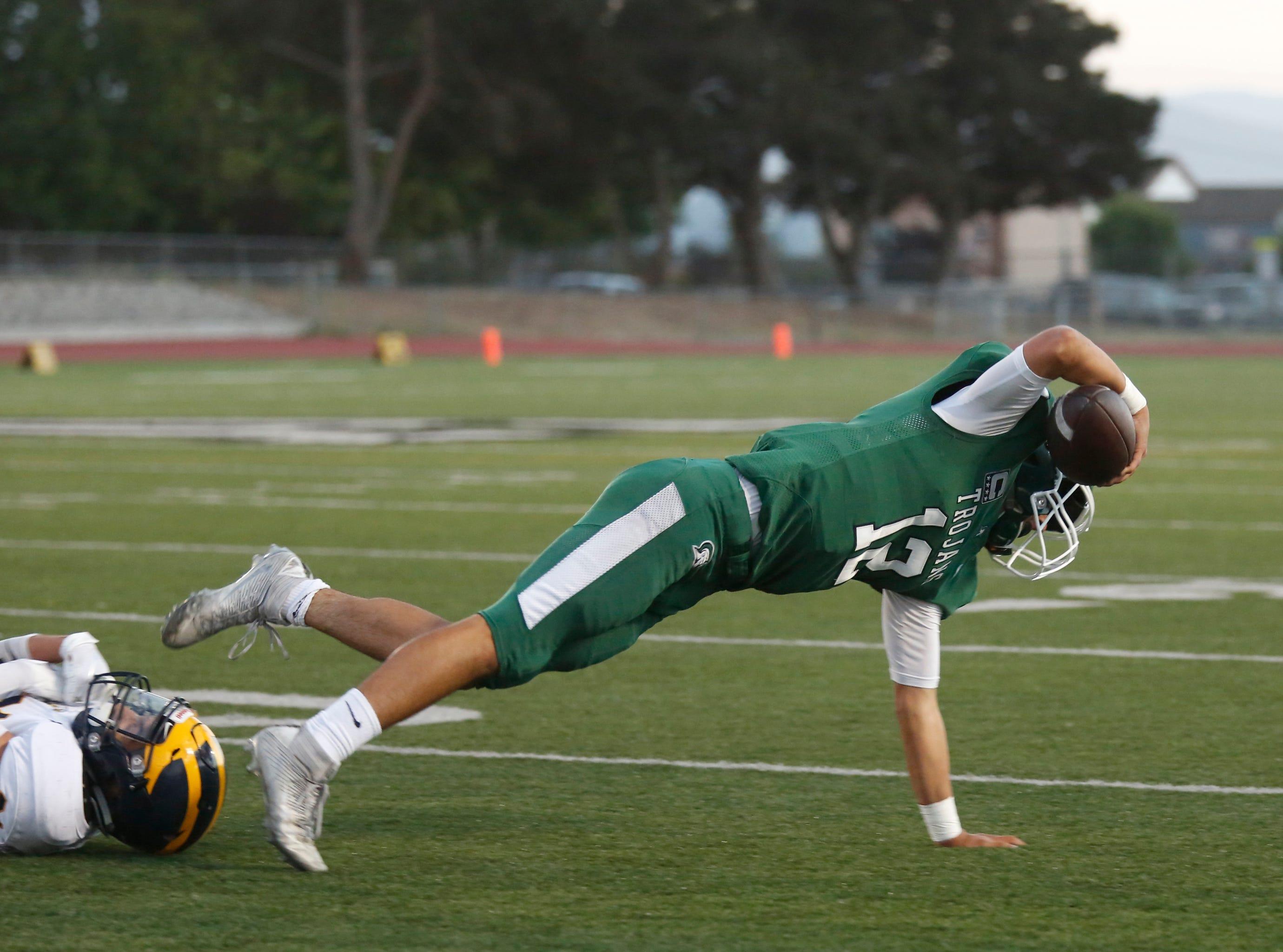 Alisal's quarterback Julian Renteria runs the ball against Everett Alvarez during football at Alisal High School in Salinas on Friday August 31, 2018. (Photo By David Royal)