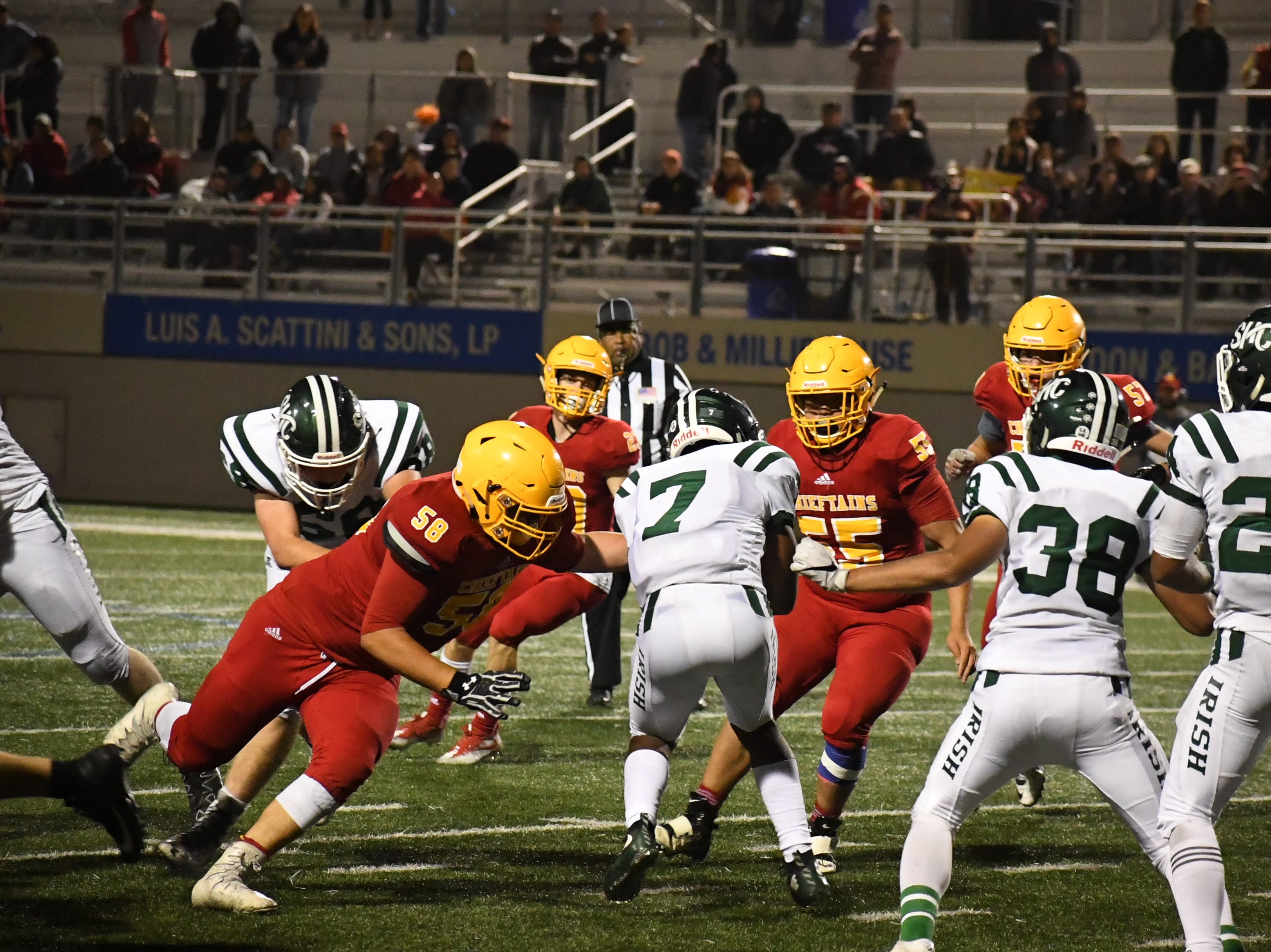 Palma defenders Daniel Cabrera (58) and Jeric Magsambol (55) fill the gap to tackle a Sacred Heart Cathedral wide receiver.