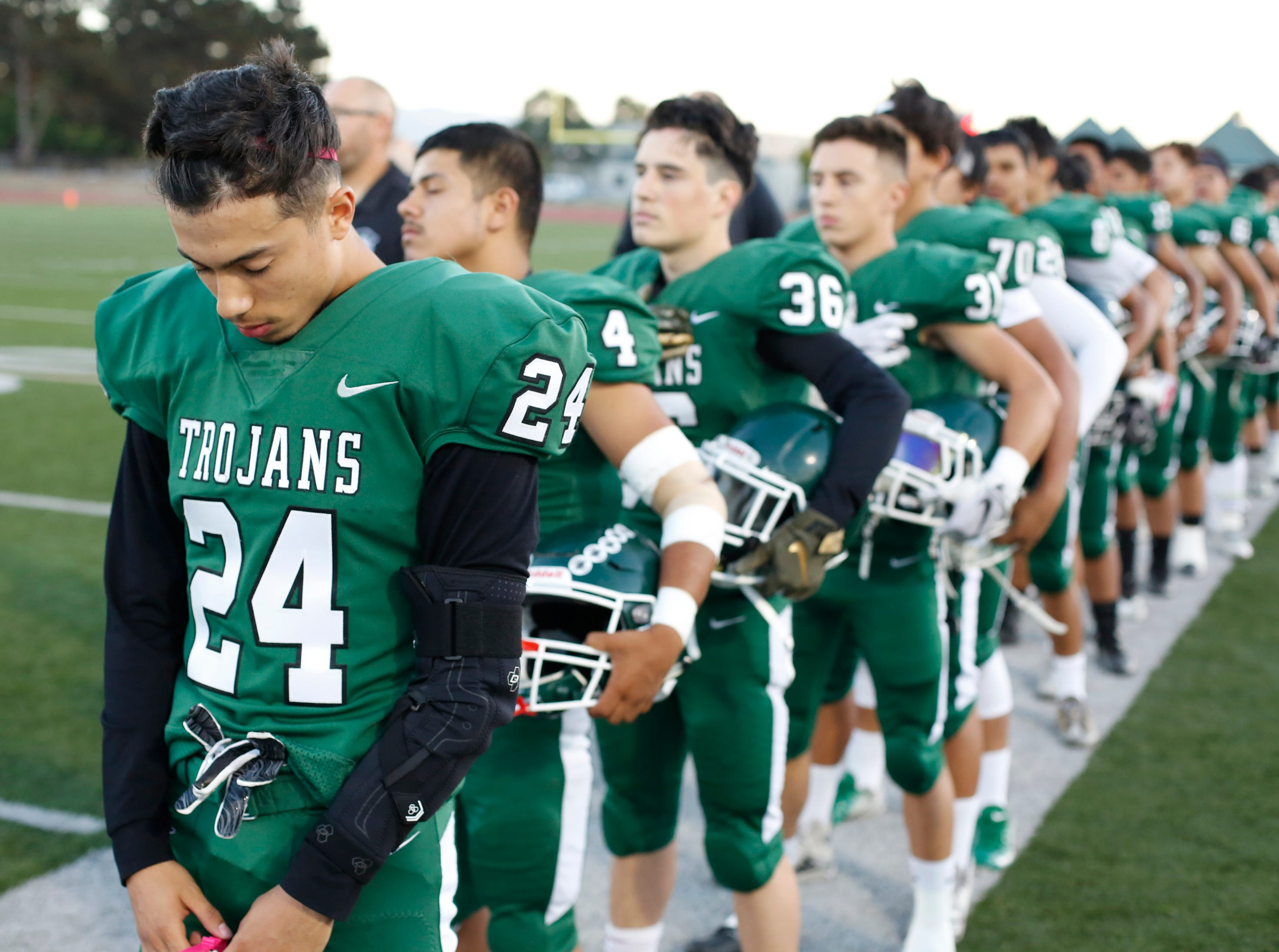 Alisal's Eduardo Rodriquez bows his head before taking the field against Everett Alvarez during football at Alisal High School in Salinas on Friday August 31, 2018. (Photo By David Royal)