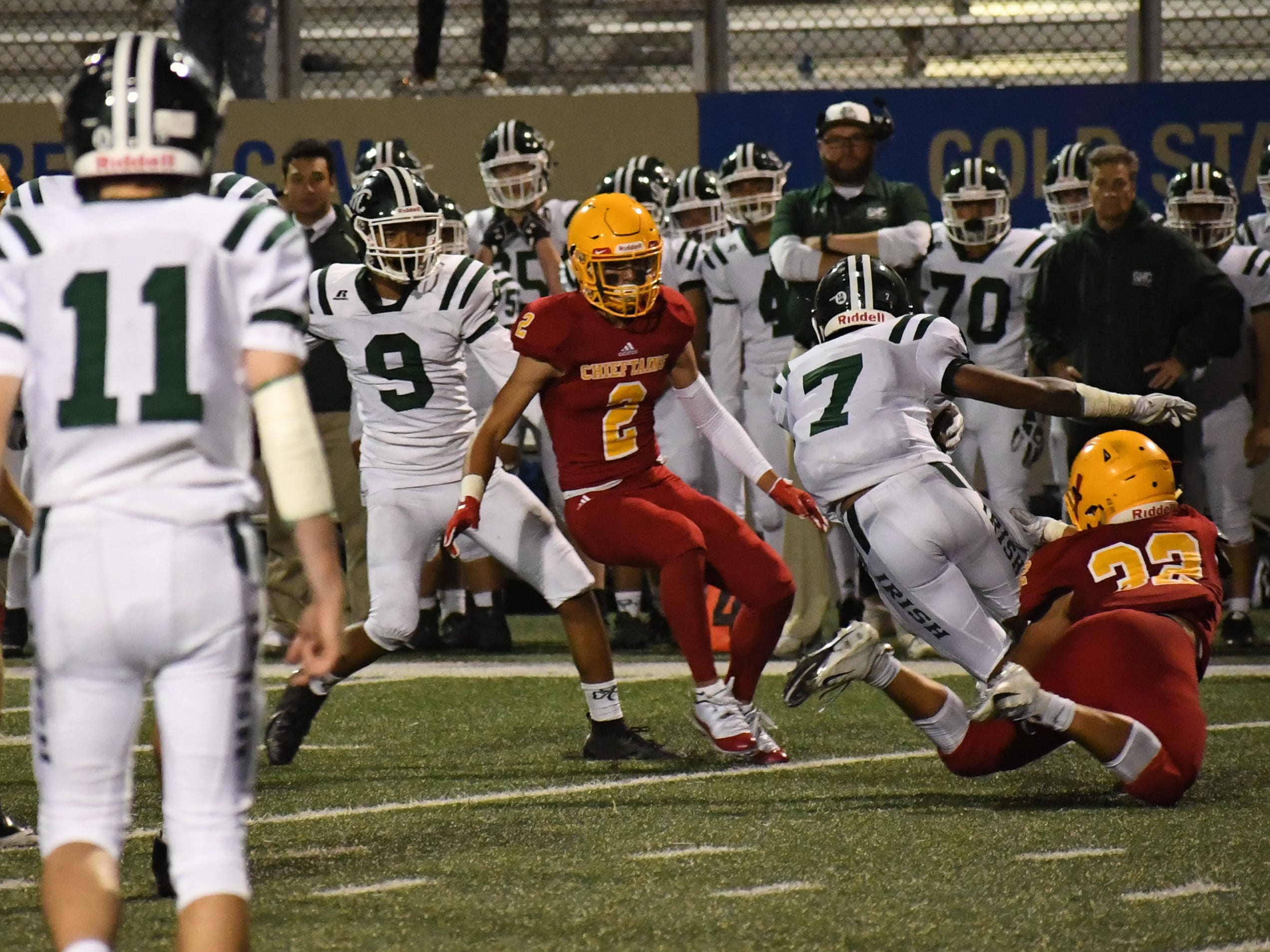 Palma defenders Diego Guajardo (32) and Matteo Martinez (2) close in on a Sacred Heart Cathedral wide receiver.