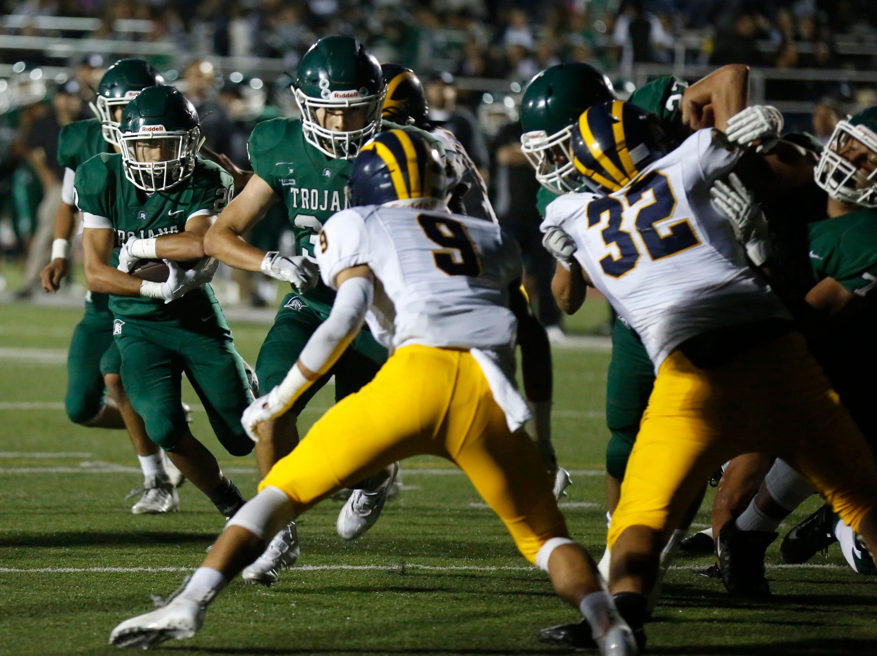 Alisal's Hernan Alvarez runs the ball against Everett Alvarez during football at Alisal High School in Salinas on Friday August 31, 2018. (Photo By David Royal)
