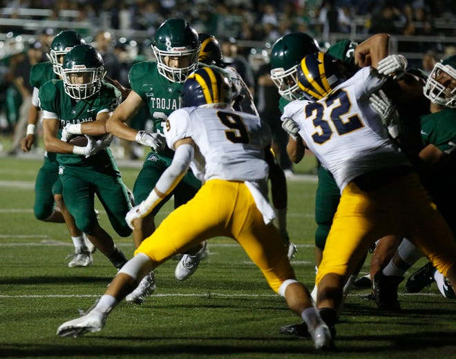 Alisal's Hernan Alvarez runs the ball against Everett Alvarez during football at Alisal High School in Salinas on Friday August 31, 2018. (Photo By David Royal)
