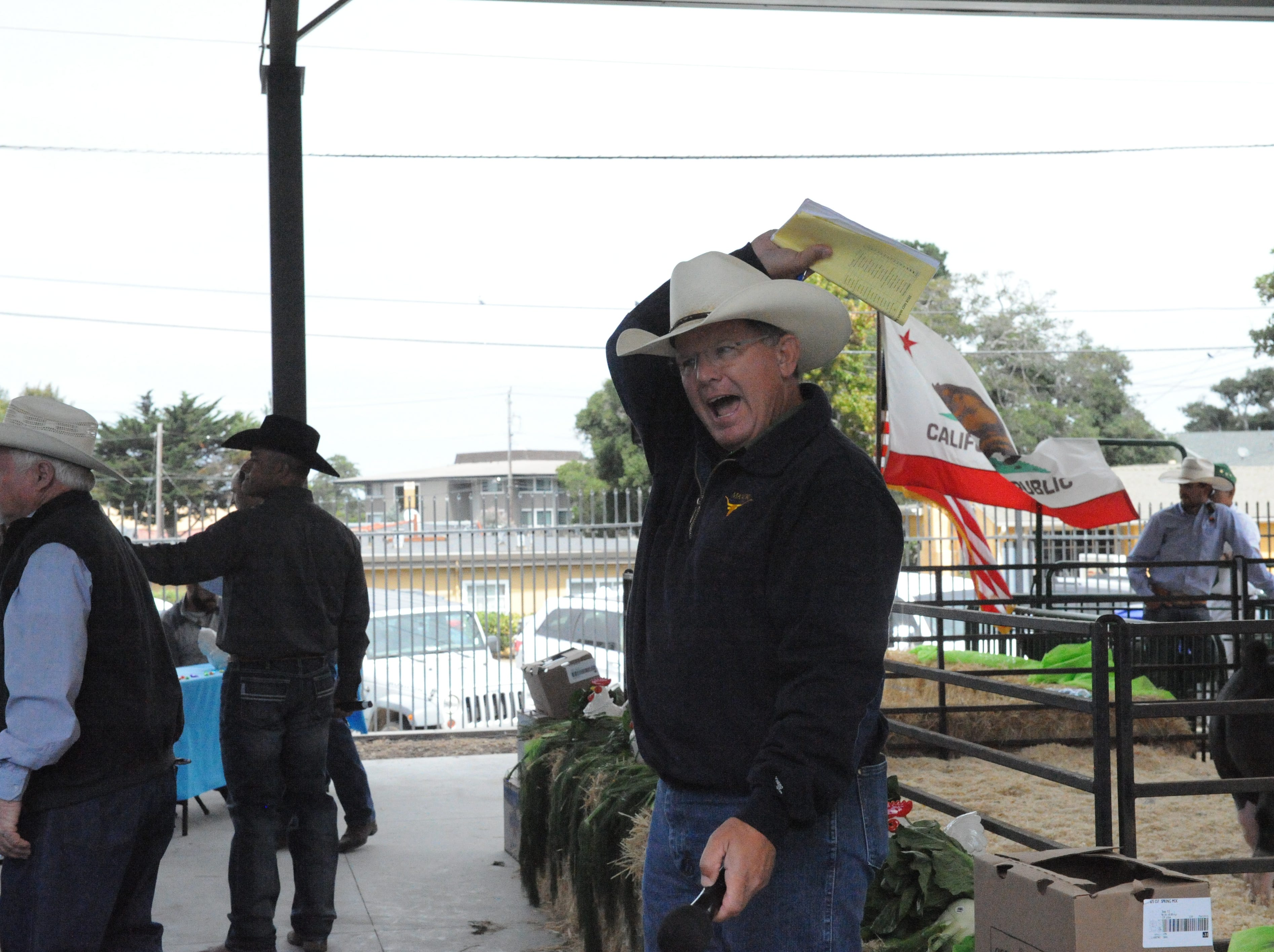 Monterey County Sheriff Steve Bernal assists in the Junior Livestock Auction at the Monterey County Fair on Saturday.