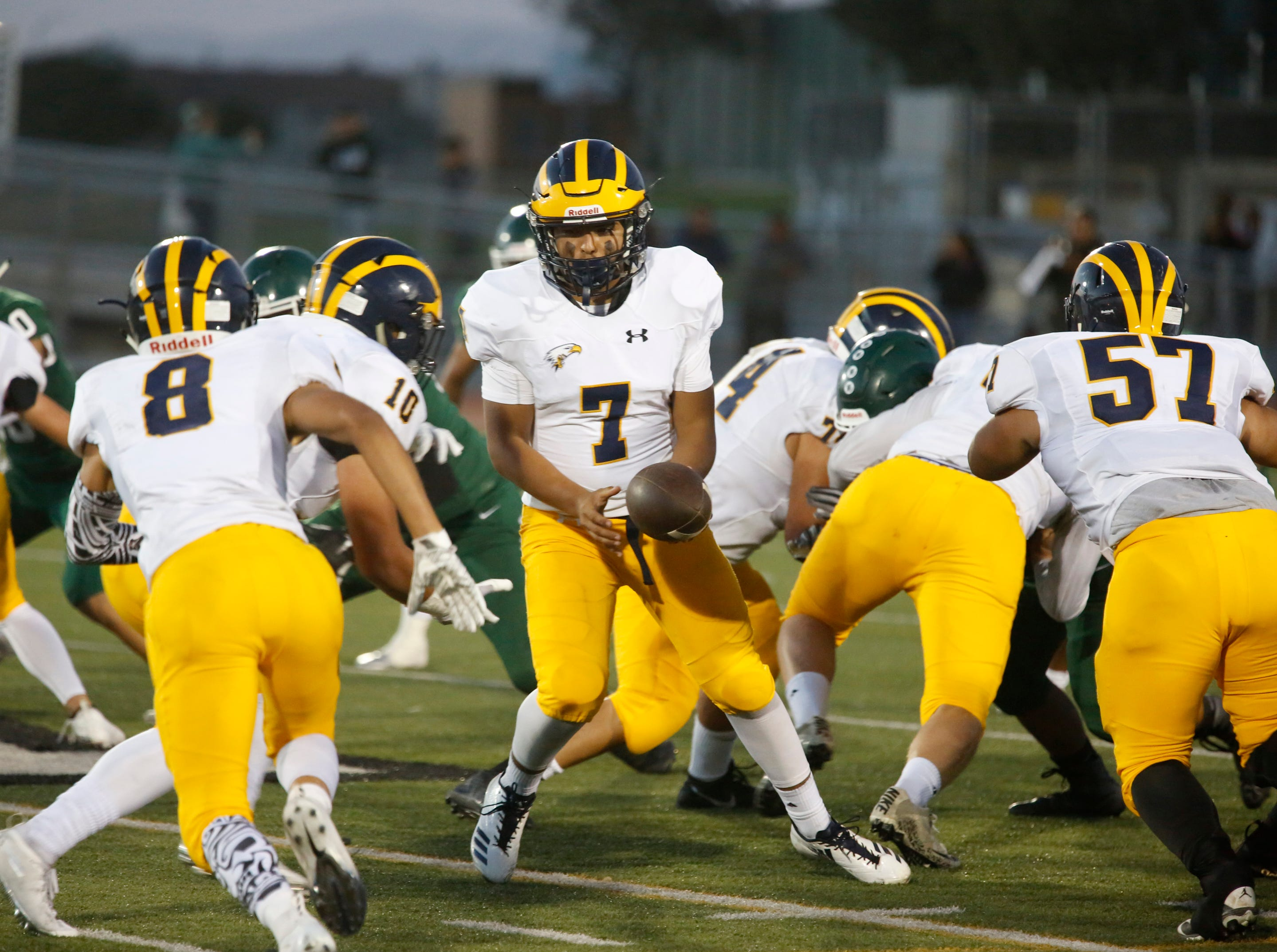 Everett Alvarez's quarterback Ben Perez prepares to hand off during football at Alisal High School in Salinas on Friday August 31, 2018. (Photo By David Royal)