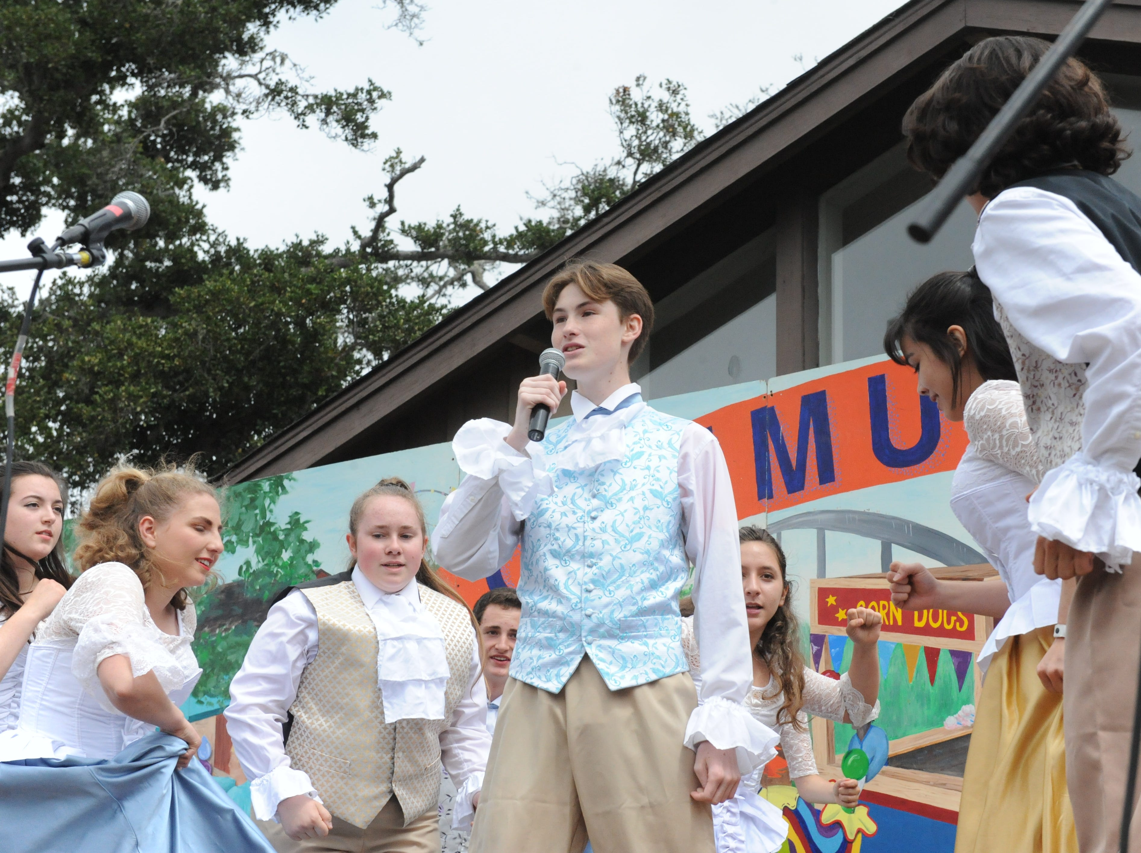 A group from the Carmel Academy of Performing Arts sings a rendition of the Broadway musical Hamilton at the Monterey County Fair Saturday.