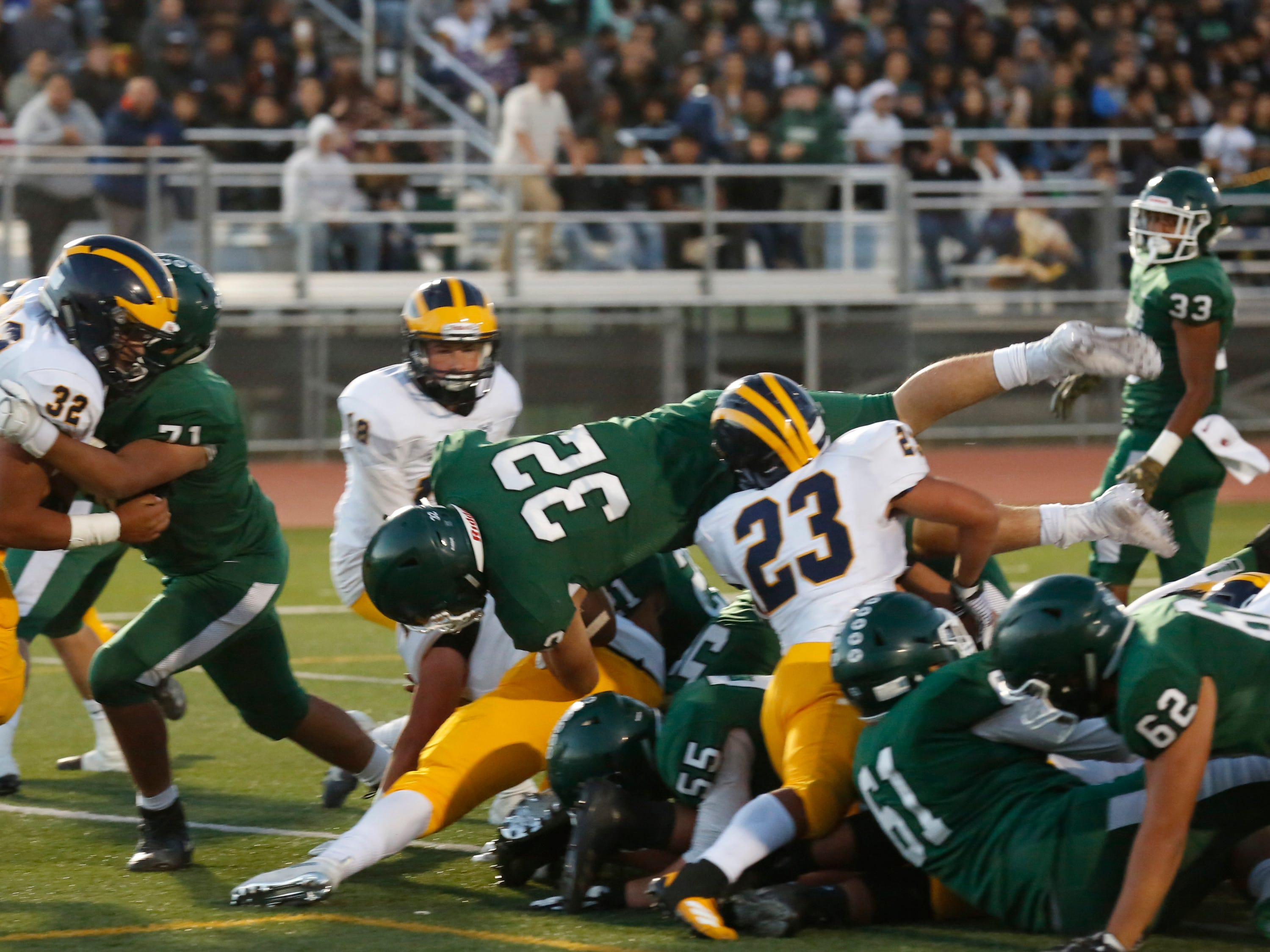Alisal's Dorian Segovia (32) goes up and over for a touchdown against Everett Alvarez during football at Alisal High School in Salinas on Friday August 31, 2018. (Photo By David Royal)