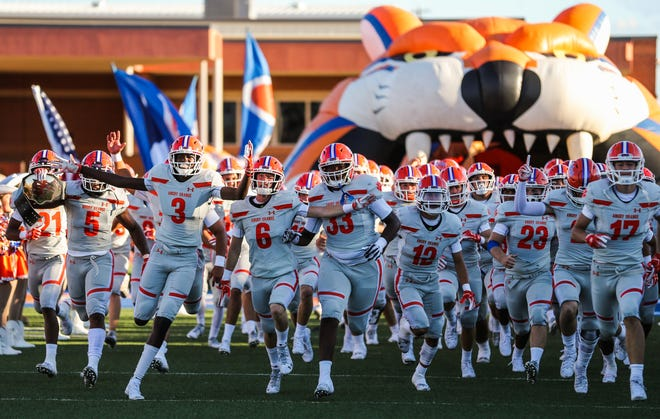 Central Bobcats enter the field for the game against Killeen Shoemaker Friday, Aug. 31, 2018, at San Angelo Stadium.
