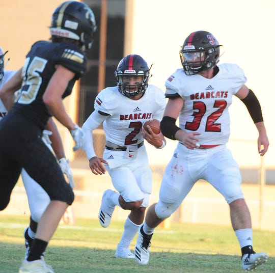 Ballinger quarterback Edgar Nunez (2) looks for an opening while teammate Cooper Bean (32) leads the way in the Bearcats' game at Brady on Friday, Aug. 31, 2018.