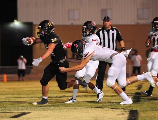 Brady running back Ryan Decker (12) scores a touchdown in overtime while Ballinger's Cody Harral (5) defends during their game Friday, Aug. 31, 2018.