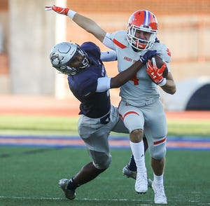 Central's Jackson Timme avoids Killeen Shoemaker's defense as he runs the ball Friday, Aug. 31, 2018, at San Angelo Stadium.