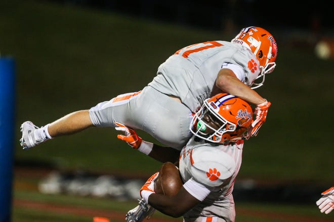 Central's Maverick McIvor jumps up on Samuel Goodloe to celebrate a touchdown in the third quarter against Killeen Shoemaker Friday, Aug. 31, 2018, at San Angelo Stadium.