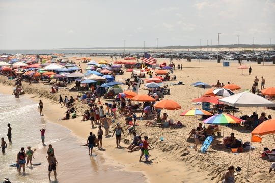 Crowds pack the beaches in Ocean City, Md. during Labor Day weekend on Saturday, Sept. 1, 2018.