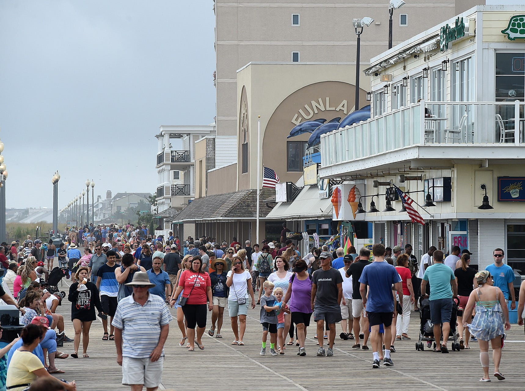 Dark and Cloudy skies have started the Labor Weekend in Rehoboth Beach but that has not deterred visitor's  who are walking the boardwalk and going to the beach. A northeast wind has the ocean churned up with Lifeguards keeping people close to shore. Special to the Daily Times / CHUCK SNYDER