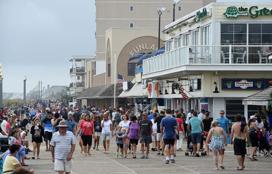 In this file photo, stormy skies didn't stop visitors from walking the Rehoboth Beach Boardwalk over last year's Labor Day weekend.