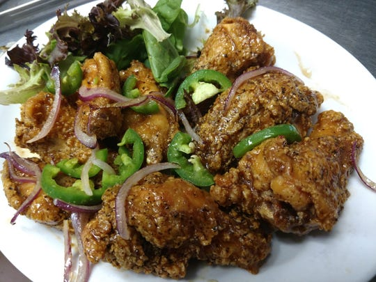 Caramelized pineapple and jalapeno wings with sesame onion and fresh peppers