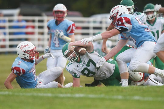 Miller/Highmore-Harrold's Jharett Bloomenrader reaches forward with the ball against Bon Home during the game Friday, Aug 31, at Bon Homme in Tyndall.