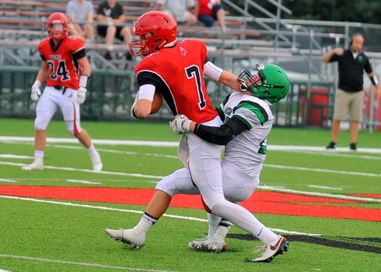 Yankton's Michael Drotzmann is brought down by a Pierre T.F. Riggs player on Friday, Aug. 31, in Yankton.