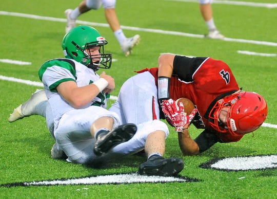 Yankton's Rex Ryken hauls in a reception against Pierre T.F. Riggs on Friday, Aug. 31, in Yankton.