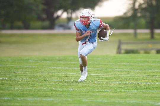 Bon Homme's Joey Slama runs the ball down the field for the first touchdown of the game against Miller/Highmore-Harrold Friday, Aug 31, at Bon Homme in Tyndal.