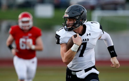 Willard's Reece Dawson carries the ball down field as the Tigers take on the Ozark Tigers at Ozark on Friday, Aug. 31, 2018.