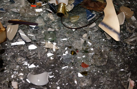 Broken glass, plates, and furniture are all that's left after a session in the Rage Room on Thursday, Aug. 30, 2018.
