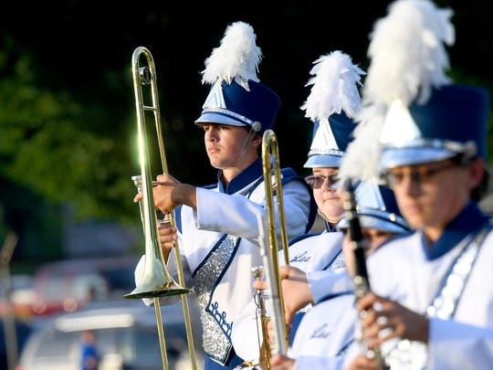 Members of Robert E. Lee's marching band take the field to perform the national anthem before the start of a football game played in Staunton on Friday. August 31, 2018.