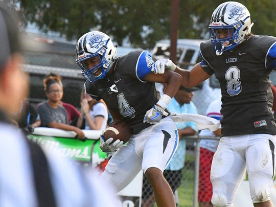 Robert E. Lee's Aarian Brown celebrates a touchdown with teammate Treyvn West during a football game played in Staunton on Friday. August 31, 2018.