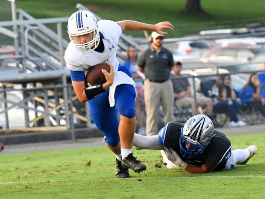 Rockbridge County quarterback Ty Riley breaks free of a tackle during a football game played in Staunton on Friday. August 31, 2018.