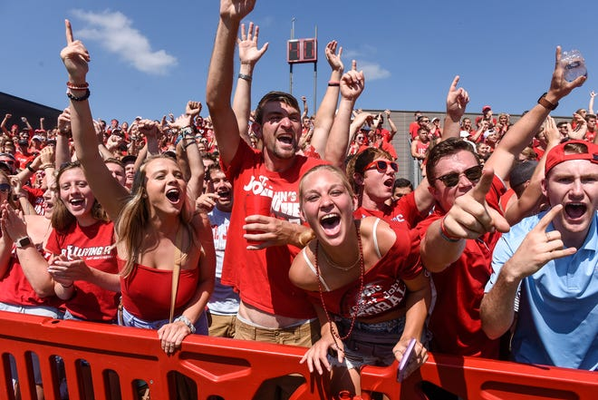 St. John's fans cheer for their team following a touchdown during the Saturday, Sept. 1, game at Clemens Stadium in Collegeville.
