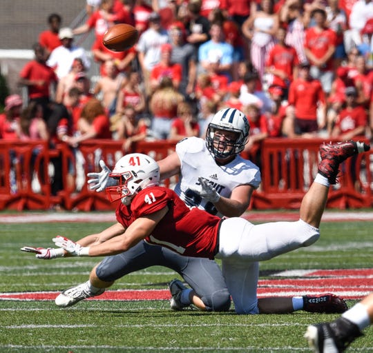 Richard Carriveau grabs for a loose ball last season at Clemens Stadium in Collegeville. The senior linebacker from Sauk Rapids is focused on helping the fourth-ranked Johnnies win Saturday at Carleton.