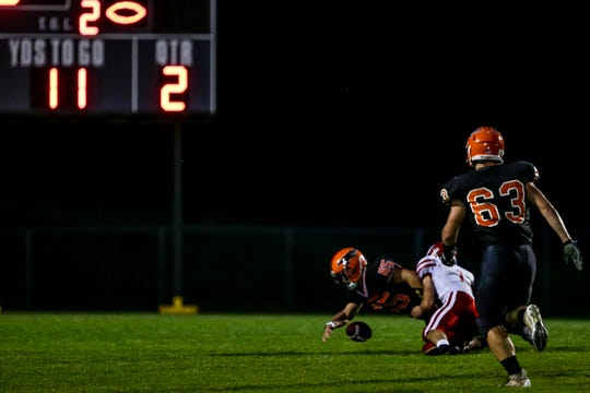Iola-Scandinavia's Carter Snyder is brought down after recovering a blocked punt in the first half against Weyauwega-Fremont at Thunderbird Field in Scandinavia on Friday night.