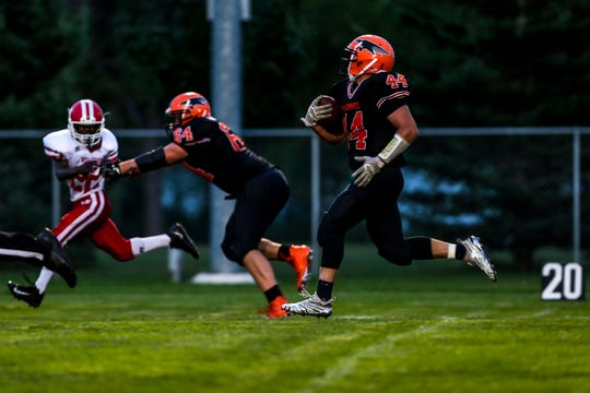 Bryce Huettner of Iola-Scandinavia runs towards the end zone during a football game between Iola-Scandinavia and Weyauwega-Fremont in Scandinavia, Wis., August 31, 2018.