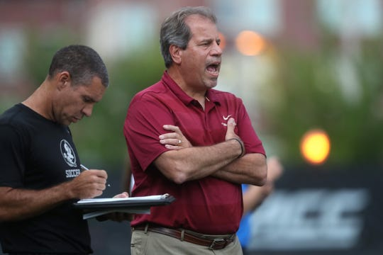 FSU Head Coach Mark Krikorian yells out to his team during their match against the University of Southern California at the Seminole Soccer Complex on Friday, Aug. 31, 2018.