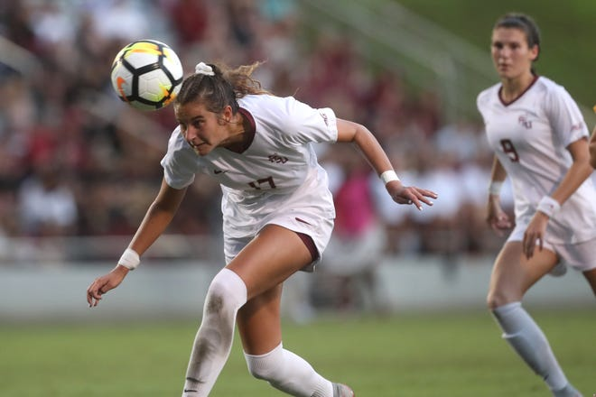 FSU's Malia Berkely heads the ball back to her own goalkeeper during their match against he University of Southern California at the Seminole Soccer Complex on Friday, Aug. 31, 2018.