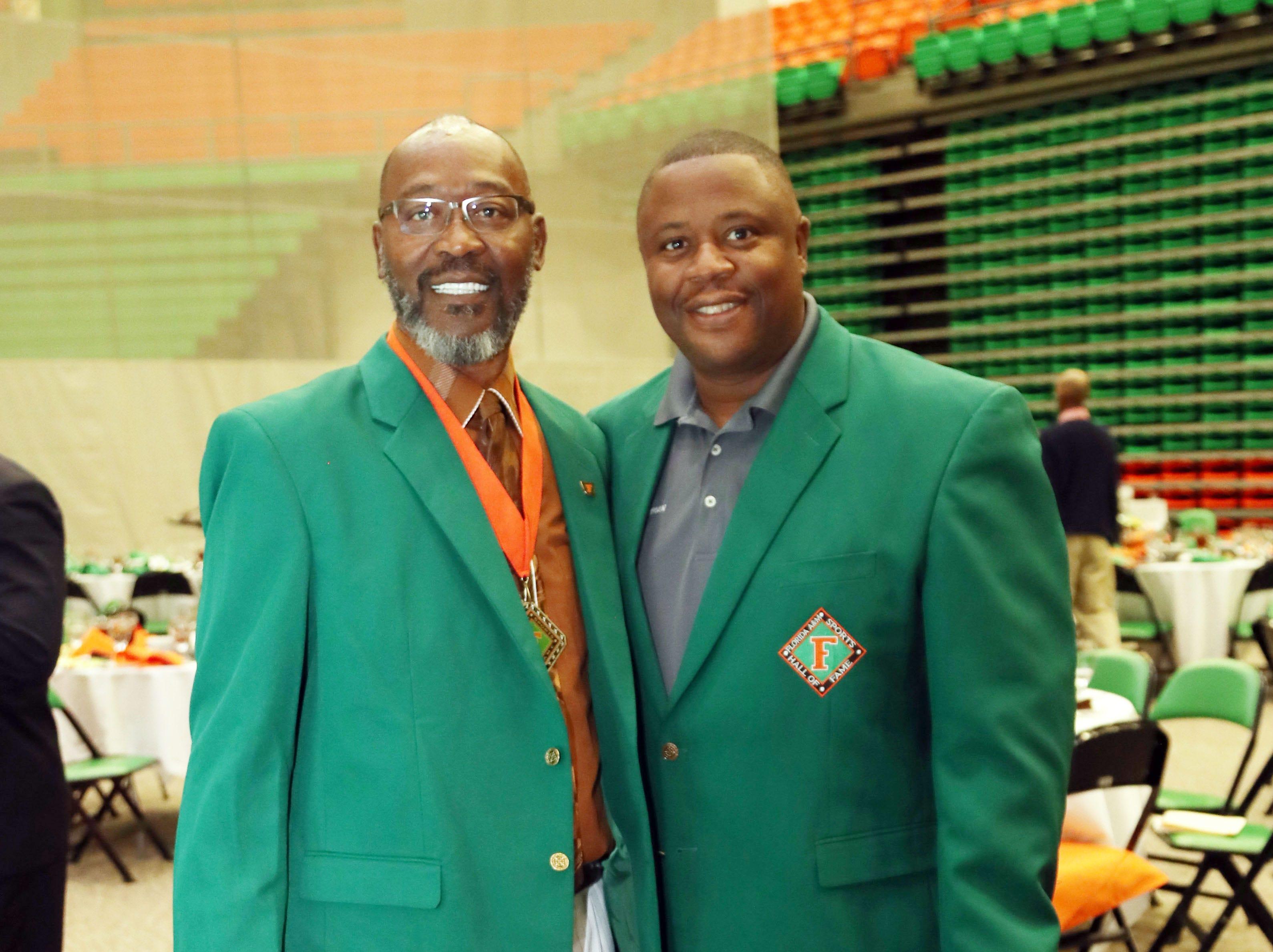 "Bryan ""Sack Man"" Brewer (left) catches up with FAMU sports information director Vaughn Wilson."