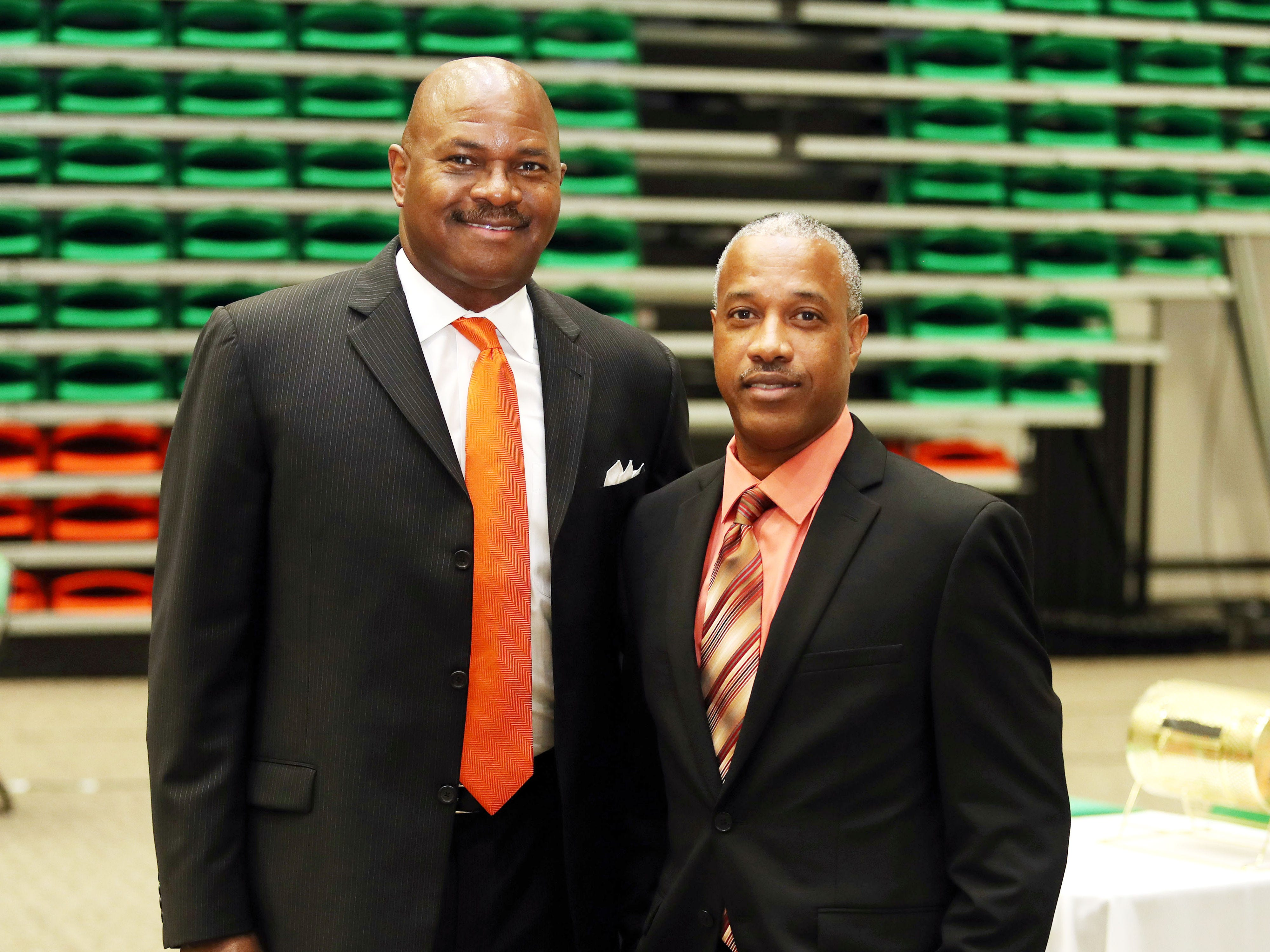Terry Giles (right) shares a moment with FAMU basketball coach Robert McCullum. Giles was enshrined in the FAMU Sports Hall of Fame.
