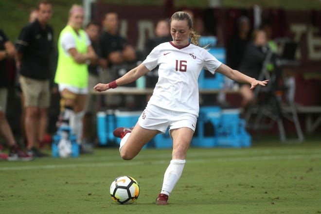 FSU's Gabby Carle strikes the ball against the University of Southern California during their match at the Seminole Soccer Complex on Friday, Aug. 31, 2018.