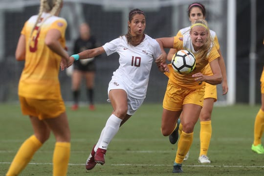 FSU's Deyna Castellanos battles against the University of Southern California's Jalen Woodward for the ball during their match at the Seminole Soccer Complex on Friday, Aug. 31, 2018.