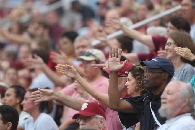 FSU's fans do the Tomahawk Chop in the stands during their match against the University of Southern California at the Seminole Soccer Complex on Friday, Aug. 31, 2018.