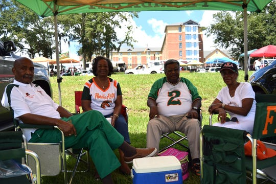 (From left to right) Former Rattler offensive lineman Curtis Miranda, Elizabeth Miranda, Godfrey Jenkins and Karen Jenkins wait for the start of FAMU's season Saturday at Bragg Memorial Stadium.