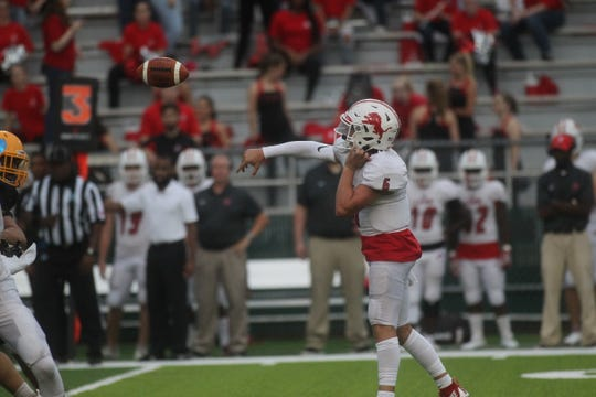 Leon quarterback Paxton Tomaini throws a pass as Leon beats Rickards 22-21 at Gene Cox Stadium on Friday, Aug. 31, 2018.