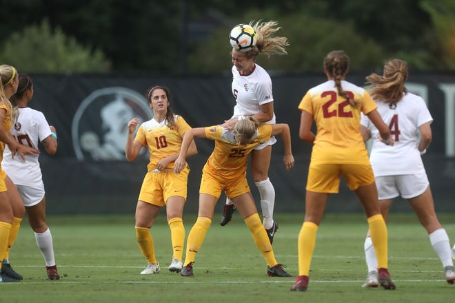 FSU's Jaelin Howell heads the ball over the University of Southern California's Samantha Trinceri during their match at the Seminole Soccer Complex on Friday, Aug. 31, 2018.