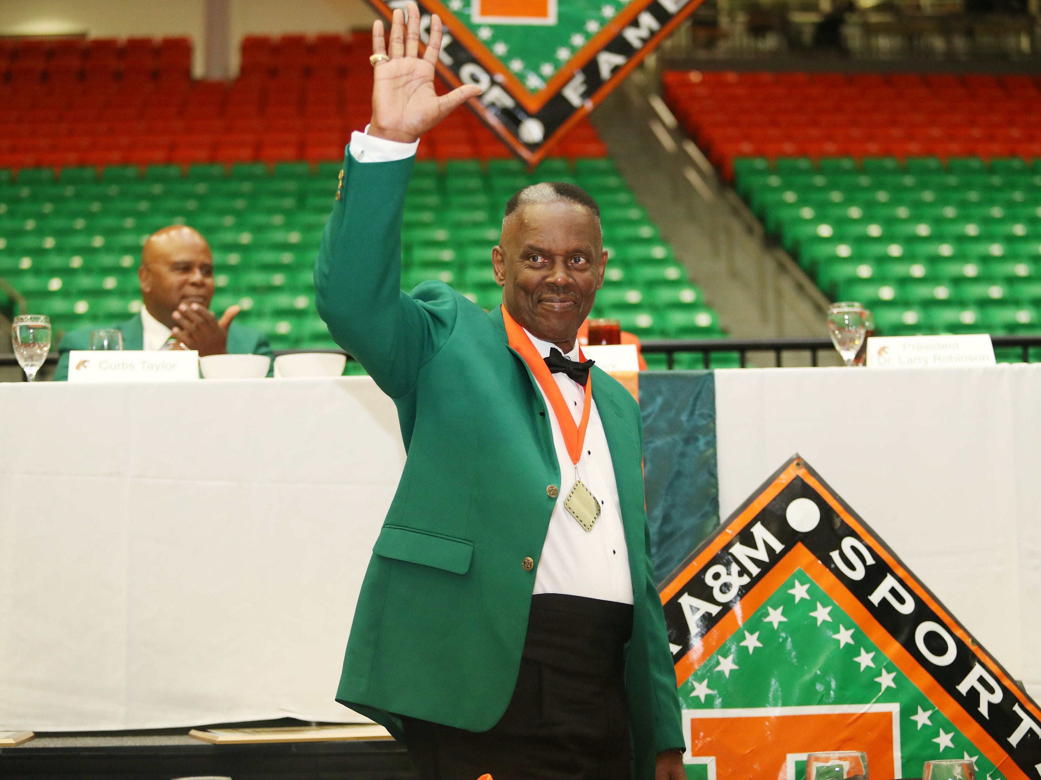 Former FAMU quarterback Stephen Scruggs waves to the crowd. Scruggs is one of the newest members of the Hall of Fame.