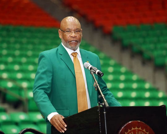 FAMU athletics director Dr. John Eason gives commentary at the Hall of Fame enshrinement ceremony.
