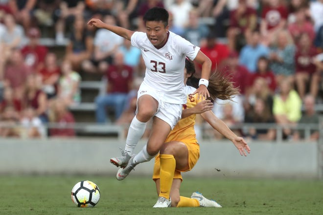 FSU's Yujie Zhao leaps over the University of Southern California's Savannah DeMelo during their match at the Seminole Soccer Complex on Friday, Aug. 31, 2018.